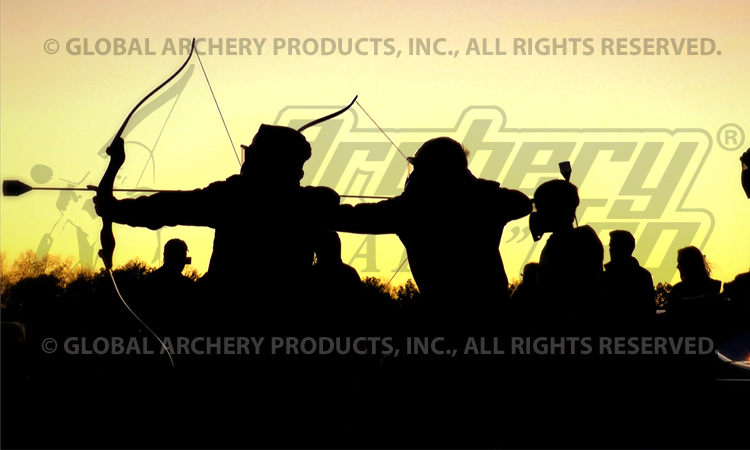 Silhouette of archers as sun sets.